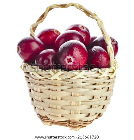 Cranberries in wicker basket isolated on white background - stock photo