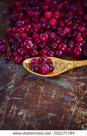 cranberries on the old table - stock photo