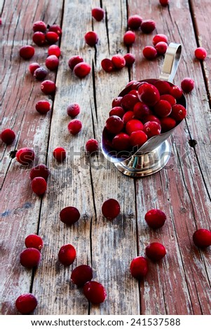 Cranberries over rustic wooden background. Selective focus - stock photo