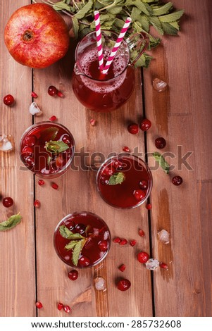 Cranberry and pomegranate cocktail with mint garnish, selective focus. Toned image - stock photo
