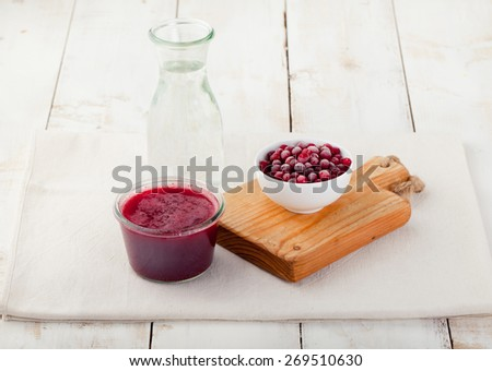 Cranberry, cranberry juice, mors , lemonade on a white wooden background - stock photo