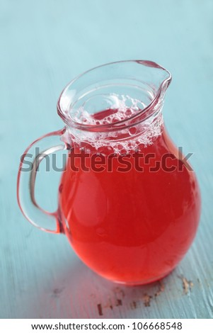Cranberry juice in a glass jug - stock photo