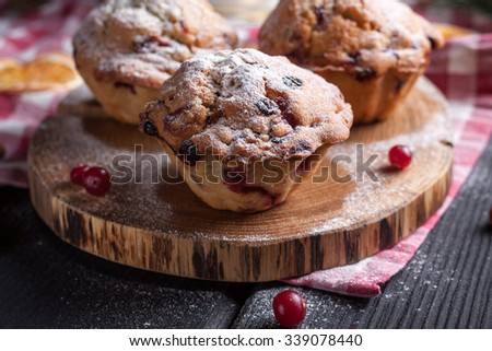 Cranberry muffin on black background