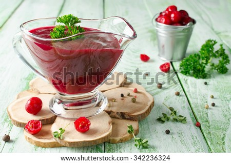 Cranberry sauce for meat and fish. Selective focus - stock photo