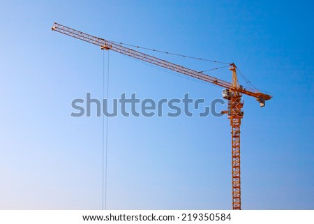Crane and a cloudless sky - stock photo