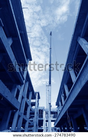 Crane and building at a construction site, china - stock photo