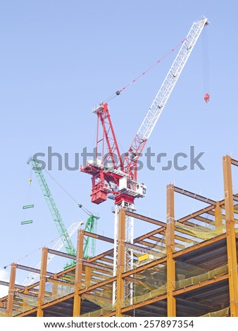 Crane and construction site - stock photo