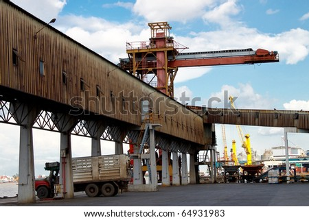 Crane and logistic way just near to river - stock photo