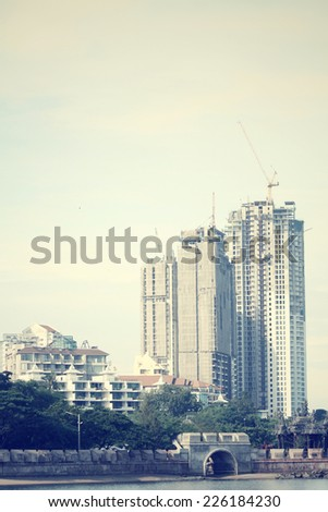 Crane and unfinished building