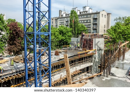 Crane and unfinished building, modern construction