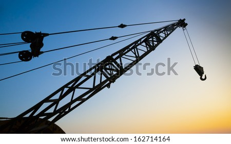 Crane Arm at Sunset - stock photo