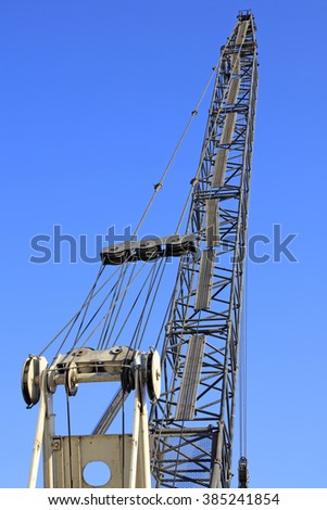 crane arm under blue sky background