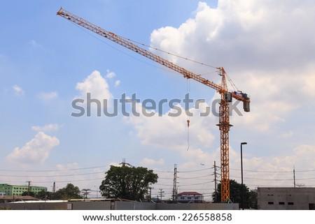 Crane at construction site - stock photo