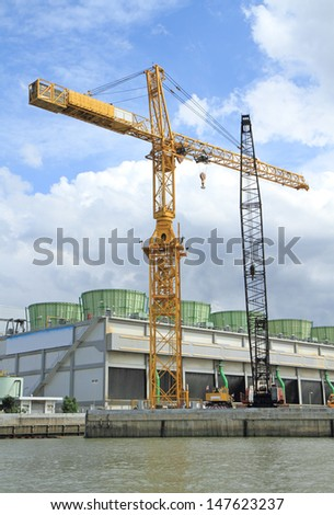 Crane at construction site by the river
