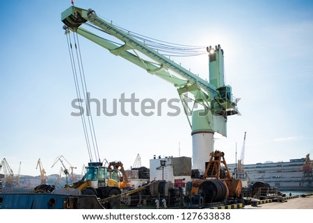 crane barge against blue sky - stock photo