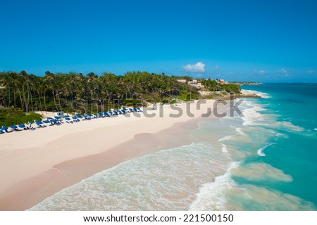 Crane Beach is one of the most beautiful beaches on the Caribbean island of Barbados. It is a tropical paradise with palms hanging over turquoise sea - stock photo