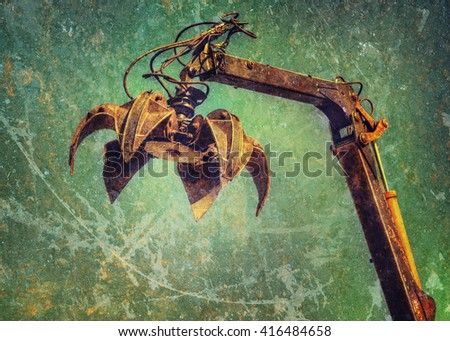 Crane claw on up in recycling center.  - stock photo