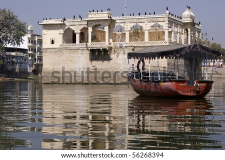 Crane colony on old buildings in Lake Pichola - stock photo