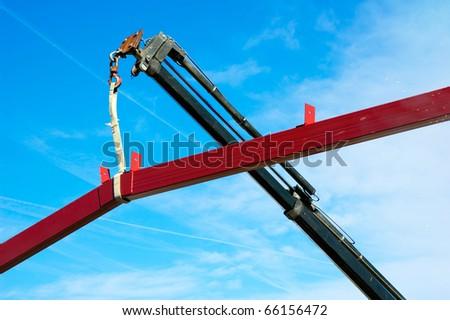 Crane elevating iron construction - stock photo