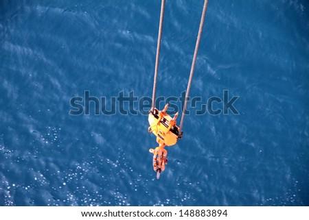 Crane hook sea background - stock photo