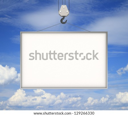 crane hook with blank billboard and blue sky - stock photo