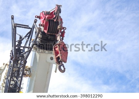 Crane Hook with blue sky - stock photo