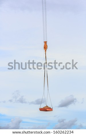 crane hook with soil in the board - stock photo