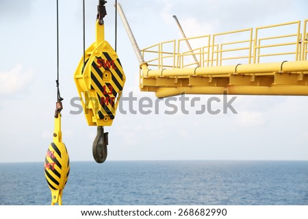 Crane hooks on work site, Crane on Oil and gas platform for transfer cargo and Controlled by Crane operator. Crane background and empty area for text. - stock photo