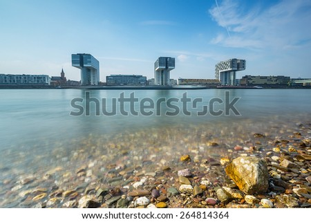 crane houses building in cologne at the rhine shore in summer - stock photo