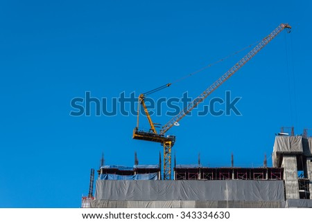 Crane in construction site - stock photo