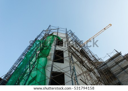 Crane is used in the construction of  buildings.