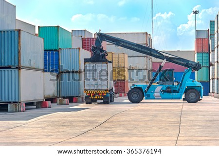 Crane lifting up container in port beautiful  blue sky background - stock photo