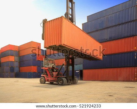 Crane lifting up container in yard, control loading Containers box from Cargo freight ship, Forklift handling container box loading to truck in import export logistics