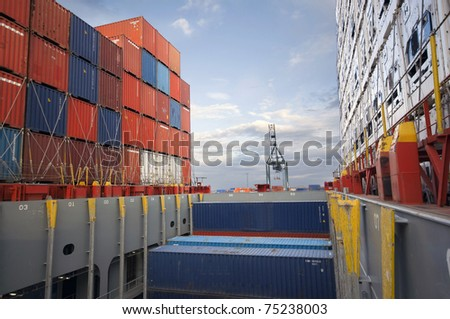 crane lifts container during cargo operation in port - stock photo