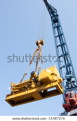 Crane load over blue sky - stock photo