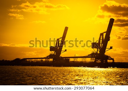 Crane loader and conveyors to transport coal. - stock photo