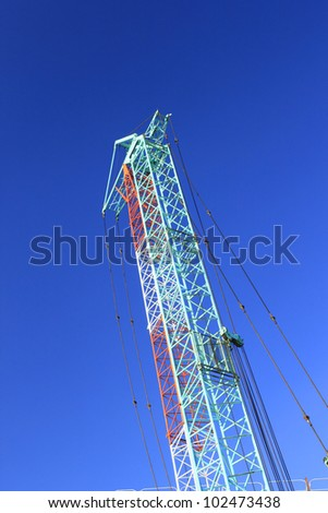 Crane (machine) against blue sky