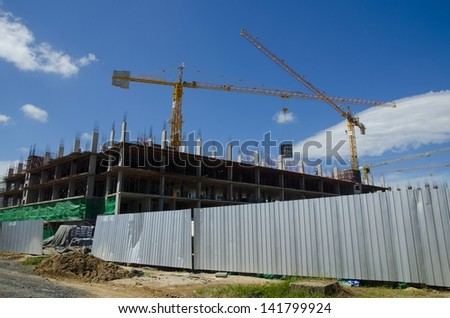 crane near building on blue sky background