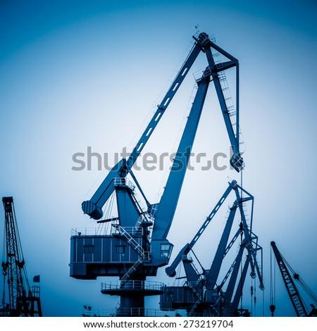 crane of harbor in sunset. - stock photo