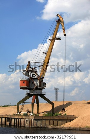 Crane on the river - stock photo