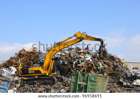 Crane picking up garbage - stock photo
