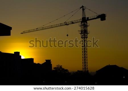 crane silhouette twilight - stock photo