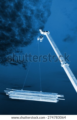 Crane sling under the blue sky and white clouds, at a construction site, china