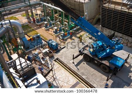 crane standing on a construction site under construction petrochemical plants - stock photo