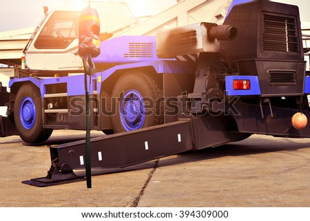crane truck outrigger stabilizing legs extended. pump truck outrigger Heavy duty steel crane outrigger pad in construction site . - stock photo