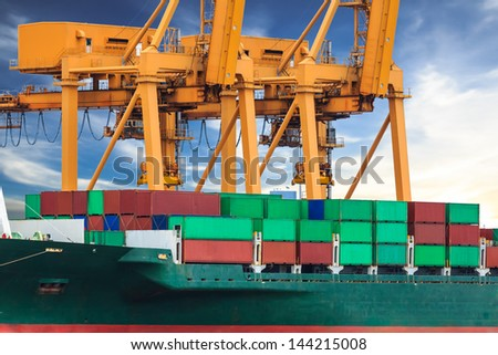 crane working with container cargo in shipyard - stock photo