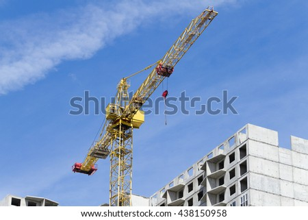 Cranes and building construction on the blue sky