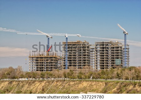 Cranes and buildings construction site