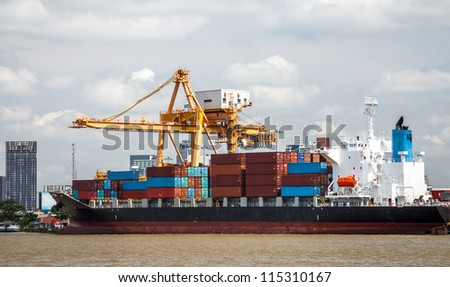 Cranes And Containers On Industrial Ship