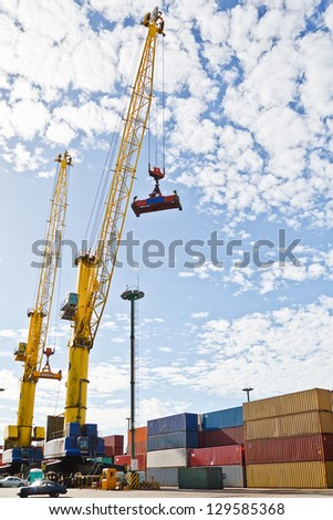 Cranes and containers on the port of Montevideo, Uruguay, with a blue sky.